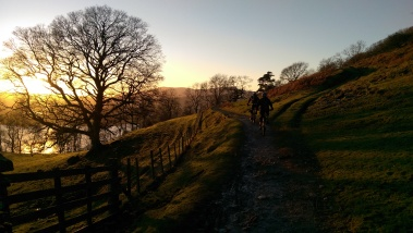 Sunset while mountain biking in the lake district near ambleside, mountain and tree silhouette